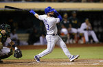 Kansas City Royals' Nick Dini watches his RBI sacrifice fly off Oakland Athletics' Brett Anderson during the fifth inning of a baseball game Tuesday, Sept. 17, 2019, in Oakland, Calif. (AP Photo/Ben Margot)