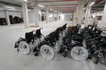 New wheelchairs sit in the empty Isabel Zendal new hospital during the official opening in Madrid, Spain, Tuesday, Dec. 1, 2020. Authorities in Madrid are holding a ceremony to open part of a 1,000-bed hospital for emergencies that critics say is no more than a vanity project, a building with beds not ready to receive patients and unnecessary now that contagion and hospitalizations are waning. Spain has officially logged 1.6 million infections and over 45,000 deaths confirmed for COVID-19 since the beginning of the year. (AP Photo/Paul White)