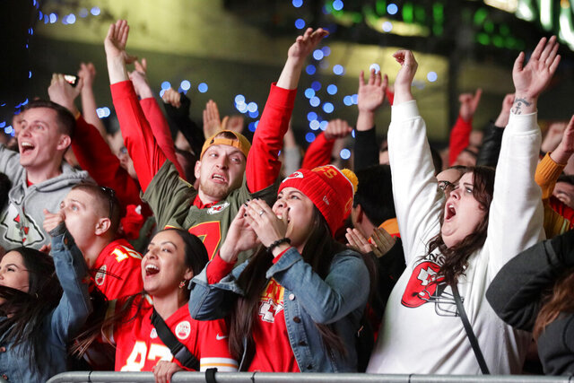 Kansas City Chief fans celebrate a fourth quarter Super Bowl touchdown in Kansas City, Mo., Sunday, Feb. 2, 2020. (AP Photo/Orlin Wagner)