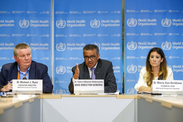 FILE - In this file photo dated Monday, March 9, 2020, Tedros Adhanom Ghebreyesus, director general of the World Health Organization, centre, speaks during a news conference on updates regarding on the coronavirus COVID-19, at the WHO headquarters in Geneva, Switzerland. Accompanying Tedros are Michael Ryan, left, executive director of WHO's Health Emergencies program, and Maria van Kerkhove, right, technical lead of WHO's Health Emergencies program. The way WHO handled the global response to the COVID-19 pandemic is under scrutiny, facing calls for the U.N. health agency to be overhauled and WHO has bowed to demands for an independent review. (Salvatore Di Nolfi/Keystone FILE via AP)