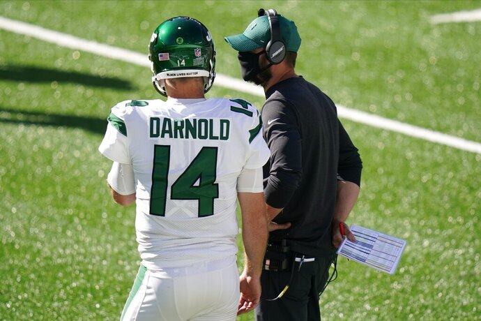 New York Jets head coach Adam Gase, right, talks to quarterback Sam Darnold (14) during the second half of an NFL football game against the San Francisco 49ers, Sunday, Sept. 20, 2020, in East Rutherford, N.J. (AP Photo/Corey Sipkin)