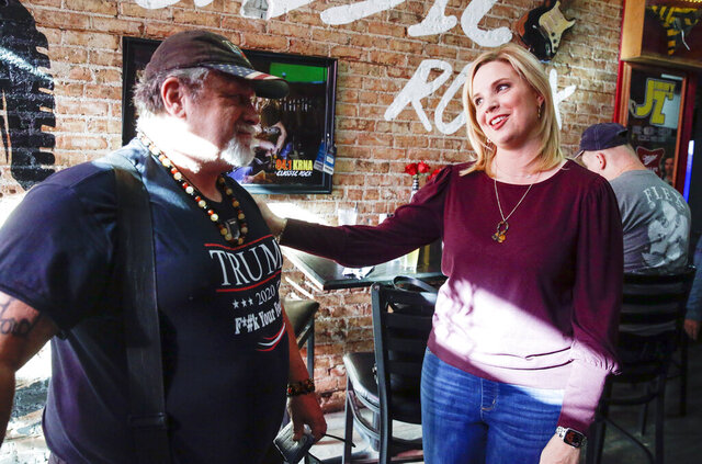 Republican candidate for Iowa's First Congressional District Ashley Hinson meets supporter Mervyn Cousins of Cedar Rapids, Iowa, at Jimmy Z's in Cedar Rapids on Tuesday, Nov. 3, 2020. (Jim Slosiarek/The Gazette via AP)