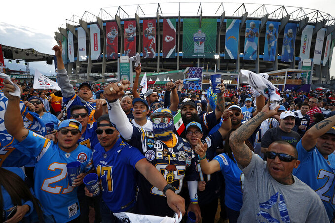 Fans cheer before an NFL football game between the Los Angeles Chargers and the Kansas City Chiefs, Monday, Nov. 18, 2019, in Mexico City. (AP Photo/Rebecca Blackwell)
