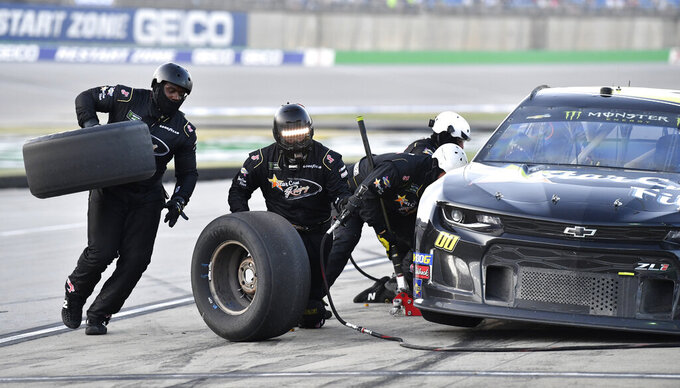 Landon Cassill makes a pit stop during the NASCAR Cup Series auto race at Kentucky Speedway in Sparta, Ky., Saturday, July 13, 2019. (AP Photo/Timothy D. Easley)