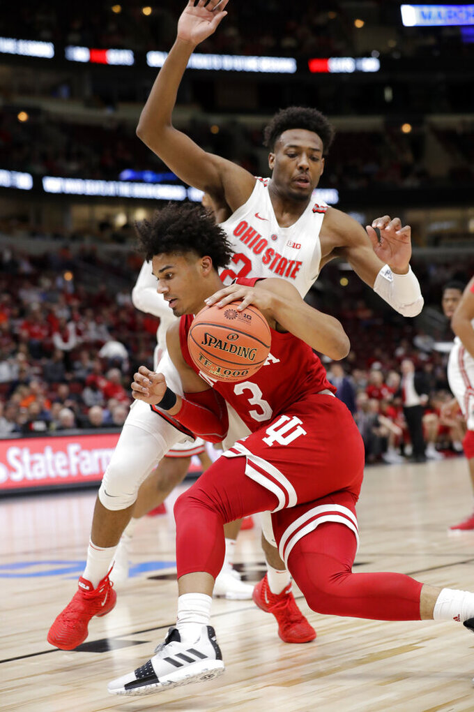Indiana's Justin Smith (3) drives against Ohio State's Andre Wesson (24) during the first half of an NCAA college basketball game in the second round of the Big Ten Conference tournament, Thursday, March 14, 2019, in Chicago. (AP Photo/Nam Y. Huh)