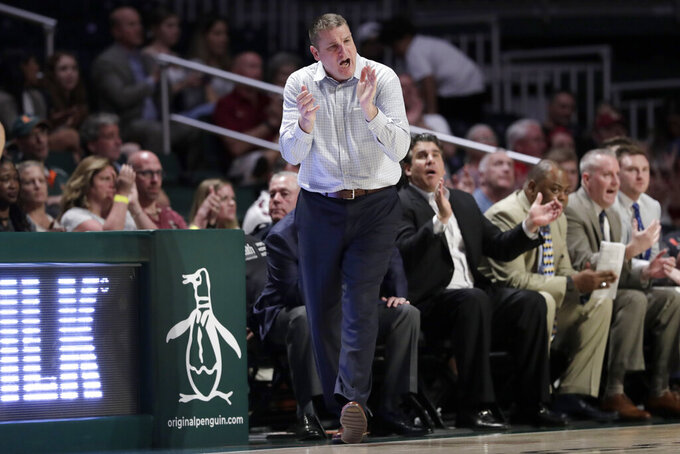 Boston College head coach Jim Christian watches during the second half of an NCAA college basketball game against Miami, Wednesday, Feb. 12, 2020, in Coral Gables, Fla. Miami won 85-58. (AP Photo/Lynne Sladky)