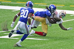 New York Giants' Isaac Yiadom, center, brings down San Francisco 49ers' Jerick McKinnon during the first half of an NFL football game, Sunday, Sept. 27, 2020, in East Rutherford, N.J. (AP Photo/Corey Sipkin)