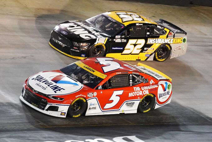 Kyle Larson (5) leads Josh Bilicki (52) through a turn during a NASCAR Cup Series auto race at Bristol Motor Speedway Saturday, Sept. 18, 2021, in Bristol, Tenn. (AP Photo/Mark Humphrey)