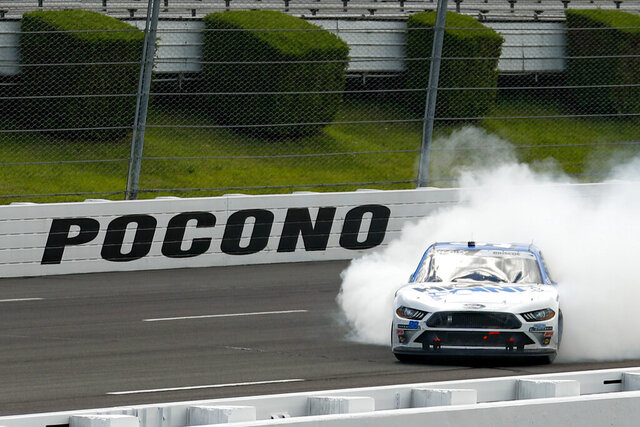 Chase Briscoe smokes his tires in celebration after winning a NASCAR Xfinity Series auto race at Pocono Raceway, Sunday, June 28, 2020, in Long Pond, Pa. (AP Photo/Matt Slocum)