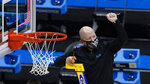 UCLA head coach Mick Cronin cuts down the net after an Elite 8 game against Michigan in the NCAA men's college basketball tournament at Lucas Oil Stadium, Wednesday, March 31, 2021, in Indianapolis. UCLA won 51-49. (AP Photo/Darron Cummings)