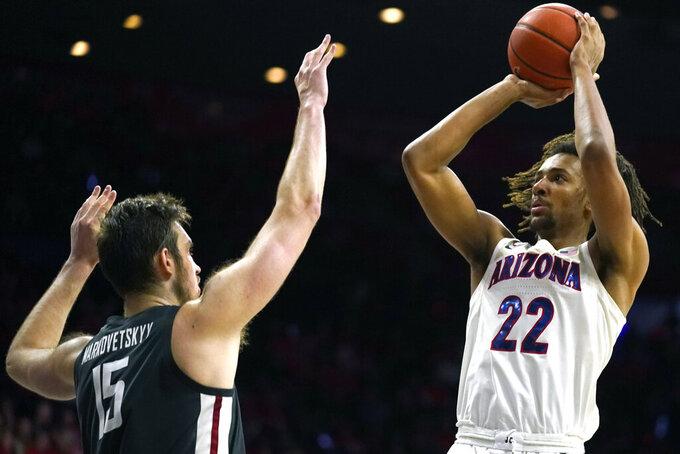 Arizona forward Zeke Nnaji (22) shoots over Washington State center Volodymyr Markovetskyy during the second half of an NCAA college basketball game Thursday, March 5, 2020, in Tucson, Ariz. Arizona won 83-62. (AP Photo/Rick Scuteri)