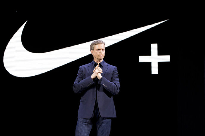 FILE - In this March 16, 2016, file photo Nike CEO Mark Parker speaks during a news conference in New York. Parker is stepping down early next year. He will be replaced by board member John Donahoe, who formerly ran e-commerce company eBay. (AP Photo/Mary Altaffer, File)