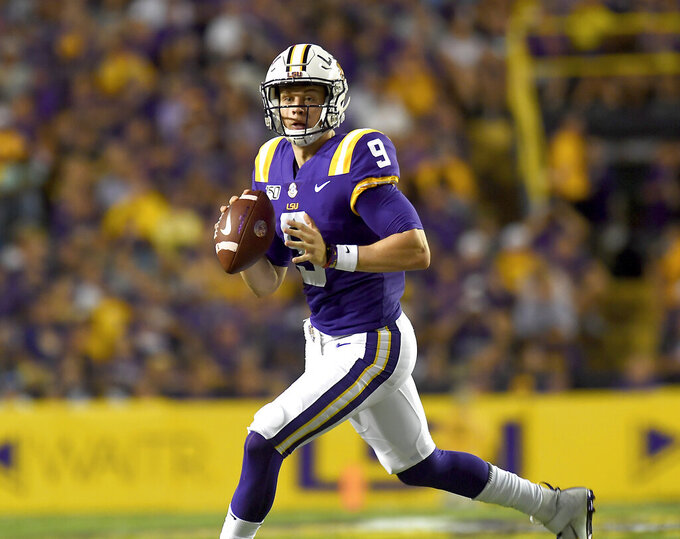 LSU quarterback Joe Burrow (9) looks for a receiver in the first half of an NCAA college football game against Northwestern State, Saturday, Sept. 14, 2019, in Baton Rouge, La. (AP Photo/Patrick Dennis)