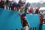 Washington Redskins wide receiver Terry McLaurin (17) greets fans at the end of an NFL football game against the Miami Dolphins, Sunday, Oct. 13, 2019, in Miami Gardens, Fla. The Redskins defeated the Dolphins 17-16. McLaurin scored two touchdowns. (AP Photo/Brynn Anderson)