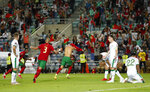 Portugal's Cristiano Ronaldo, center, celebrates after scoring his side's second goal during the World Cup 2022 group A qualifying soccer match between Portugal and the Republic of Ireland at the Algarve stadium outside Faro, Portugal, Wednesday, Sept. 1, 2021. (AP Photo/Armando Franca)