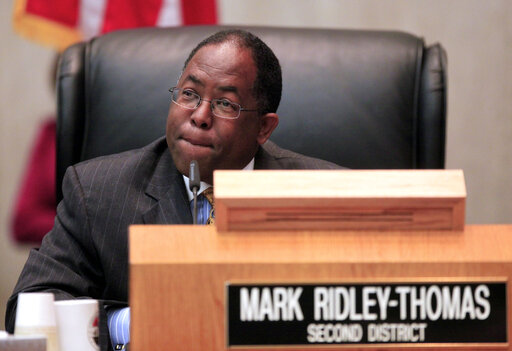 FILE - In this Jun 1, 2010, file photo, Los Angeles County Supervisor Mark Ridley-Thomas casts the deciding vote for the Board of Supervisors 3-2 vote to join the city in its economic boycott of Arizona over its SB 1070 law targeting illegal immigrants in Los Angeles. Longtime politician Mark Ridley-Thomas and the former dean of the School of Social Work at USC were indicted Thursday, Oct. .14, 2021, on federal corruption charges that allege a bribery scheme in which a Ridley-Thomas relative received substantial benefits from the university in exchange for Ridley-Thomas supporting county contracts and lucrative contract amendments with the university while he served on the Los Angeles County Board of Supervisors. (AP Photo/Damian Dovarganes, File)