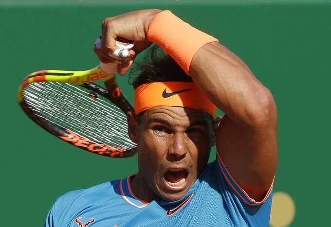 FILE  - In this April 19, 2019, file photo, Spain's Rafael Nadal returns the ball to Argentina's Guido Pella during their quarterfinal match of the Monte Carlo Tennis Masters tournament in Monaco. Every other player in the men's bracket will be pursuing Nadal as the 34-year-old from Spain pursues history at the French Open that starts Sunday, Sept. 27, 2020.(AP Photo/Claude Paris, File)