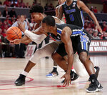 Houston guard Nate Hinton, left, and Memphis guard Alex Lomax, right, battle for a loose ball during the second half of an NCAA college basketball game Sunday, Jan. 6, 2019, in Houston. (AP Photo/Michael Wyke)