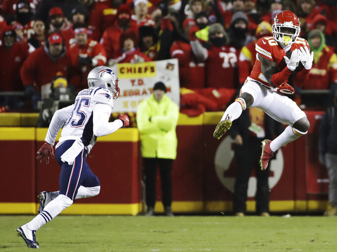 Kansas City Chiefs wide receiver Tyreek Hill (10) makes a catch against New England Patriots defensive back Keion Crossen (35) during the first half of the AFC Championship NFL football game, Sunday, Jan. 20, 2019, in Kansas City, Mo. (AP Photo/Elise Amendola)