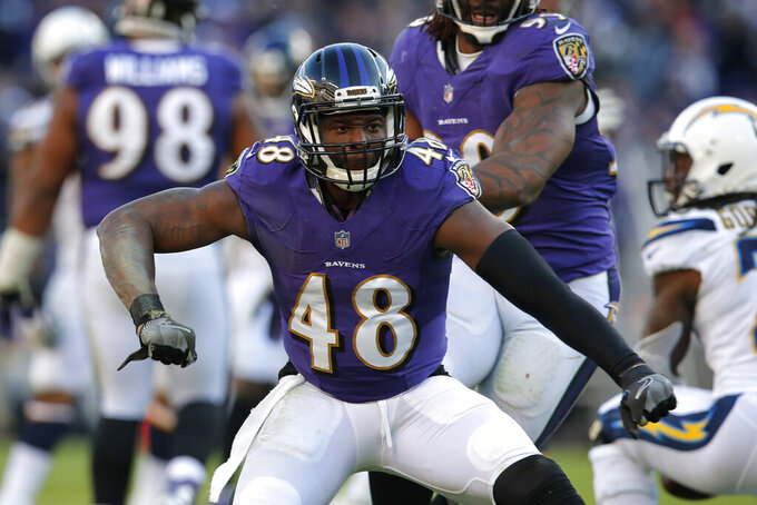 FILE - In this  Sunday, Jan. 6, 2019 file photo, Baltimore Ravens inside linebacker Patrick Onwuasor celebrates after a play in the second half of an NFL wild card playoff football game against the Los Angeles Chargers in Baltimore.  A person with direct knowledge of the deal says the New York Jets and linebacker Patrick Onwuasor have agreed to terms on a one-year contract, Wednesday, March 25, 2020.  Onwuasor played his first four NFL seasons in Baltimore and was once considered the heir apparent to C.J. Mosley with the Ravens. Now, the two are teammates again in New York. (AP Photo/Carolyn Kaster, File)