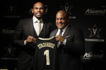 Vanderbilt basketball coach Jerry Stackhouse, left, poses for pictures with Athletics Director Malcom Turner during a news conference Monday, April 8, 2019, in Nashville, Tenn. Stackhouse was hired to replace Bryce Drew as head coach. (AP Photo/Mark Humphrey)