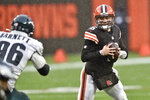 Cleveland Browns quarterback Baker Mayfield (6) tries to avoid Philadelphia Eagles defensive end Derek Barnett (96) during the first half of an NFL football game, Sunday, Nov. 22, 2020, in Cleveland. (AP Photo/David Richard)