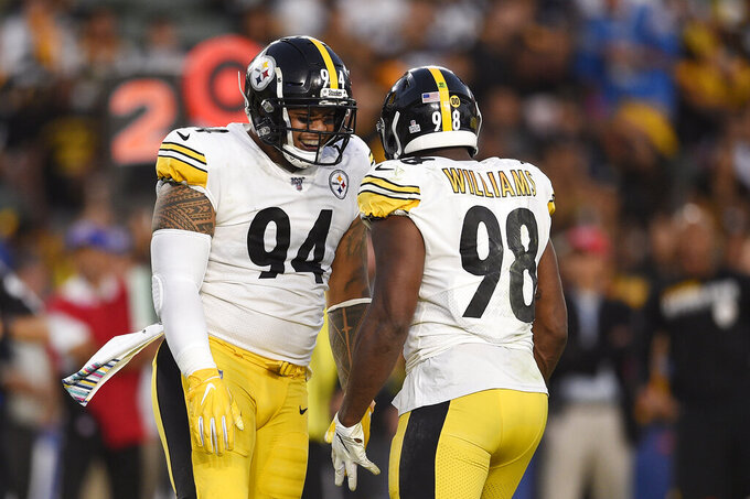 Pittsburgh Steelers defensive end Tyson Alualu, left, celebrates a sack with inside linebacker Vince Williams during the first half of an NFL football game against the Los Angeles Chargers, Sunday, Oct. 13, 2019, in Carson, Calif. (AP Photo/Kelvin Kuo)