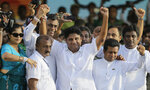 Presidential candidate of Sri Lanka's governing party Sajith Premadasa, center, waves to his supporters as he arrives at his maiden election campaign rally in Colombo, Sri Lanka, Thursday, Oct. 10, 2019. Premadasa says he will put a former army chief in charge of national security if he wins, an apparent move to counter former defense chief and front-runner Gotabaya Rajapaksa, whose campaign centers on security following last Easter's deadly suicide bomb attacks. (AP Photo/Eranga Jayawardena)