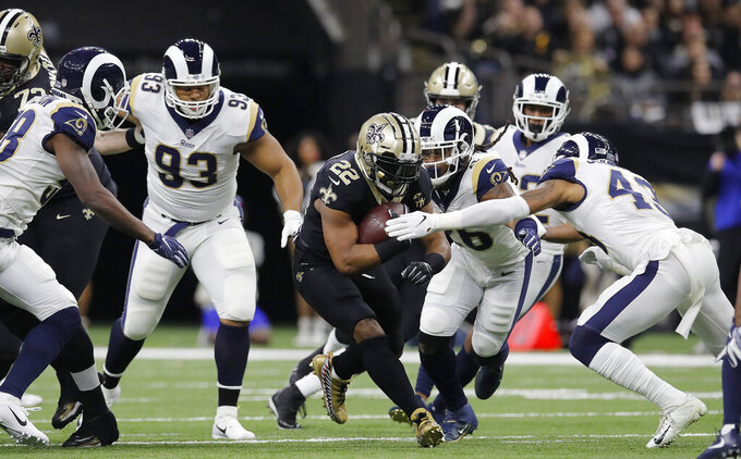New Orleans Saints' Mark Ingram runs during the first half of the NFL football NFC championship game against the Los Angeles Rams, Sunday, Jan. 20, 2019, in New Orleans. (AP Photo/Carolyn Kaster)
