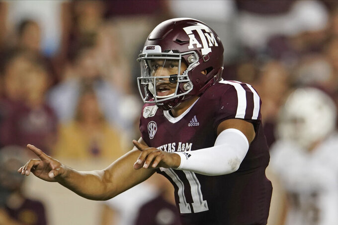 FILE - In this Aug. 29, 2019, file photo, Texas A&M's Kellen Mond (11) directs his team against Texas State during the second half of an NCAA college football game, in College Station, Texas.  Texas A&M gave Clemson one of its toughest tests during its run to the national championship last season, yet the Aggies enter the rematch as 17-point underdogs. (AP Photo/Chuck Burton, File)