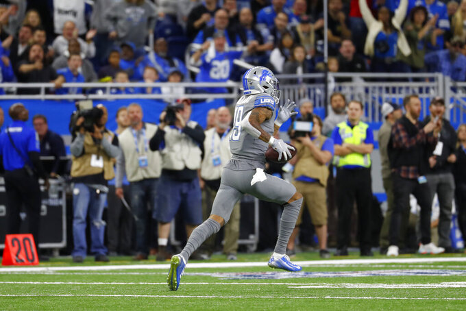 Detroit Lions wide receiver Kenny Golladay runs for a touchdown during the first half of an NFL football game against the Chicago Bears, Thursday, Nov. 28, 2019, in Detroit. (AP Photo/Paul Sancya)