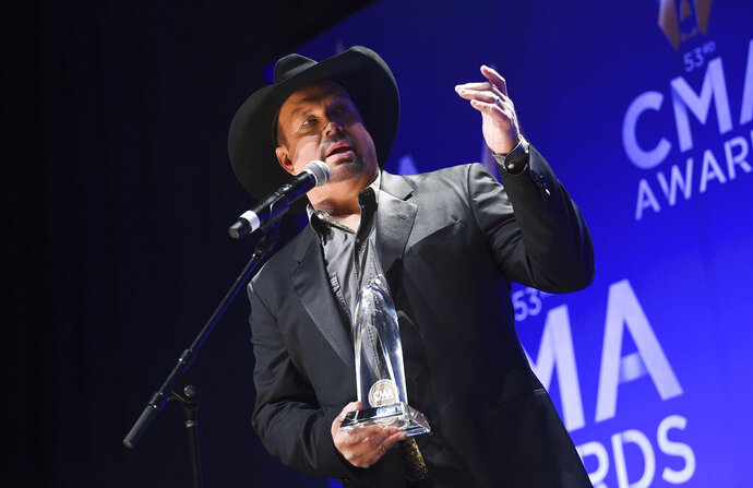 Singer-songwriter Garth Brooks speaks in the press room after winning the entertainer of the year award at the 53rd annual CMA Awards at Bridgestone Arena on Wednesday, Nov. 13, 2019, in Nashville, Tenn. (Photo by Evan Agostini/Invision/AP)