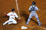 Boston Red Sox's Jarren Duran slides into home plate to score on a double by Enrique Hernandez as New York Yankees catcher Rob Brantly waits for the throw during the ninth inning of a baseball game at Fenway Park, Thursday, July 22, 2021, in Boston. (AP Photo/Elise Amendola)