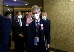 The Czech Senate President Milos Vystrcil waves to media as he walks into the meeting room of Taiwan and Czech Economic, Trade and Investment Forum in Taipei, Taiwan, Monday, Aug. 31. 2020. Vystrcil arrived in Taiwan on Sunday accompanied by Prague Mayor Zdenek Hrib and more than 80 representatives from government, business and academia arrived to Taiwan on a six-day visit. (AP Photo/Chiang Ying-ying)
