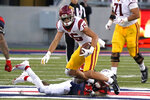 Southern California wide receiver Drake London (15) tries to get away from Arizona defensive back Quinn Sullivan (30) after a catch during the second half of an NCAA college football game Saturday, Nov. 14, 2020, in Tucson, Ariz. Southern California won 34-30. (AP Photo/Rick Scuteri)