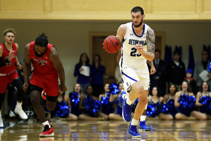 Seton Hall forward Sandro Mamukelashvili (23) brings the ball up the court during the second half of an NCAA college basketball game against Stony Brook on Saturday, Nov. 9, 2019, in South Orange, N.J. Seton Hall won 74-57. (AP Photo/Adam Hunger)