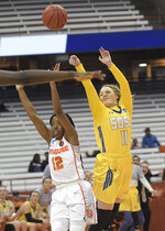 South Dakota State's Madison Guebert (11) passes the ball over Syracuse's Kiara Lewis (12) during a second-round game in the NCAA women's college basketball tournament in Syracuse, N.Y., Monday, March 25, 2019. (AP Photo/Heather Ainsworth)