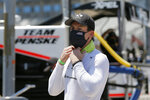 FILE - In this Saturday, June 6, 2020, file photo, Simon Pagenaud prepares for a IndyCar auto race practice at Texas Motor Speedway in Fort Worth, Texas. Pagenaud says racing hasn't been quite the same without having spectators to cheer the drivers on for the opening stages of the IndyCar season. The IndyCar series will welcome fans for the first time of the year during the REV Group Grand Prix doubleheader Saturday and Sunday, July 11-12, at Road America in Plymouth, Wisconsin. (AP Photo/Tony Gutierrez, File)
