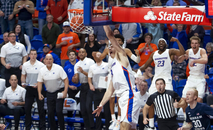 Boise State guard Justinian Jessup finishes a dunk off a steal near the end of overtime against BYU during an NCAA college basketball game Wednesday, Nov. 20, 2019, in Boise, Idaho. Boise State won 72-68. (Darin Oswald/Idaho Statesman via AP)