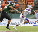 Hawaii defensive lineman Manly Williams (49) attempts to chase down Louisiana Tech quarterback J'Mar Smith (8) in the first half of the Hawaii Bowl NCAA college football game, Saturday, Dec. 22, 2018, in Honolulu. (AP Photo/Eugene Tanner)