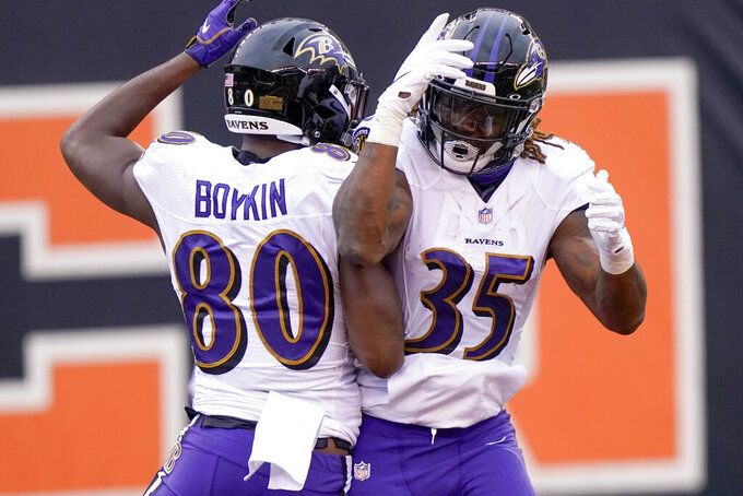 Baltimore Ravens wide receiver Miles Boykin (80) celebrates with running back Gus Edwards (35) after making a catch and taking it in for a touchdown against the Cincinnati Bengals during the first half of an NFL football game, Sunday, Jan. 3, 2021, in Cincinnati. (AP Photo/Bryan Woolston)