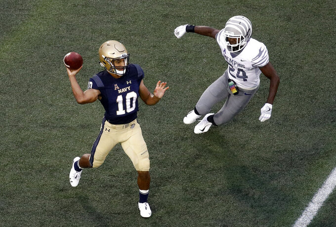 Navy quarterback Malcolm Perry, left, throws to a receiver as he is pressured by Memphis defensive back Tito Windham in the first half of an NCAA college football game, Saturday, Sept. 8, 2018, in Annapolis, Md. (AP Photo/Patrick Semansky)
