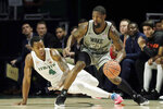 Wake Forest guard Chaundee Brown (23) and Miami forward Keith Stone (4) battle for the ball during the first half of an NCAA college basketball game, Saturday, Feb. 15, 2020, in Coral Gables, Fla. (AP Photo/Wilfredo Lee)