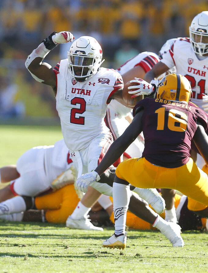 Utah running back Zack Moss (2) looks for a first down in front of Arizona State safety Aashari Crosswell in the second half during an NCAA college football game, Saturday, Nov. 3, 2018, in Tempe, Ariz. (AP Photo/Rick Scuteri)