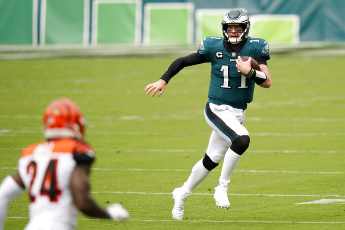 Philadelphia Eagles' Carson Wentz scrambles during the first half of an NFL football game against the Cincinnati Bengals, Sunday, Sept. 27, 2020, in Philadelphia. (AP Photo/Chris Szagola)