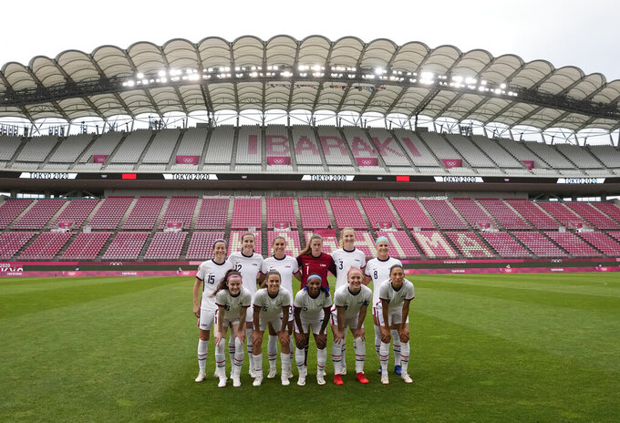 United States starting players pose for a photo prior a women's soccer match against Australia at the 2020 Summer Olympics, Tuesday, July 27, 2021, in Kashima, Japan. (AP Photo/Fernando Vergara)