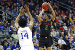 Maryland guard Aaron Wiggins (2) shoos over Seton Hall guard Jared Rhoden (14) during the first half of an NCAA college basketball game, Thursday, Dec. 19, 2019, in Newark, N.J. (AP Photo/Kathy Willens)