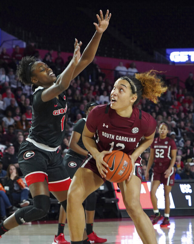 South Carolina guard Brea Beal (12) prepares to shoot past Georgia's guard Chloe Chapman (1) against during the first half of an NCAA college basketball game Sunday, Jan. 26, 2020, in Athens, Ga. (AP Photo/Tami Chappell)