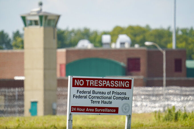 FILE - This Aug. 26, 2020 file photo shows the federal prison complex in Terre Haute, Ind. Inmates on federal death row tell The Associated Press that a leading topic of conversation through airducts they use to communicate is whether President Joe Biden will keep a campaign pledge to halt federal executions. Biden hasn't spoken publicly to that question since taking office four days after the Trump administration executed the last of 13 inmates at the Terre Haute prison where federal death row is located. (AP Photo/Michael Conroy, File)