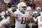 Texas' Sam Ehlinger (11) looks to pass against Baylor during the first half of an NCAA college football game in Austin, Texas, Saturday, Oct. 24, 2020. (AP Photo/Chuck Burton)